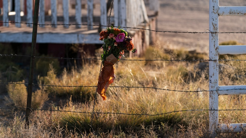 A bouquet of flowers is left to honour cinematographer Halyna Hutchins outside the Bonanza Creek Ranch in Santa Fe, N.M., Sunday, Oct. 24, 2021. (AP Photo/Jae C. Hong)