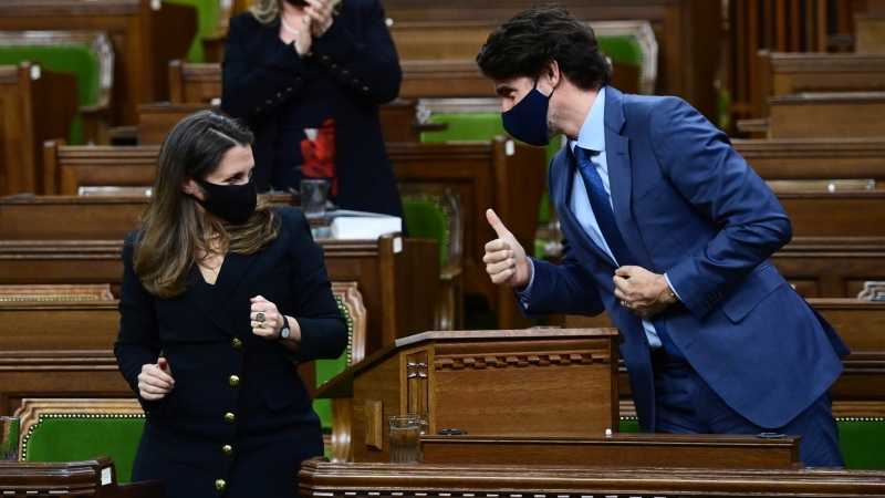 Prime Minister Justin Trudeau gives Finance Minister Chrystia Freeland the thumbs up after she delivered the federal budget in the House of Commons in Ottawa on Monday April 19, 2021. The federal government unveiled spending plans to manage the remainder of the COVID-19 crisis and chart an economic course for a post-pandemic Canada. THE CANADIAN PRESS/Sean Kilpatrick