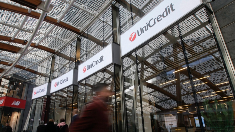 FILE -- In this Dec. 13, 2016, file photo, people walk in front of the entrance of the UniCredit tower at the Porta Nuova business district in Milan, Italy. (AP Photo/Luca Bruno)
