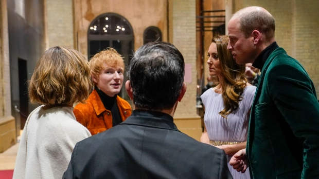 Prince William, right, and Kate, Duchess of Cambridge, second right, speak with Ed Sheeran, second left, and Emma Watson, left, as they attend the inaugural Earthshot Prize awards ceremony at Alexandra Palace in London, Oct. 17, 2021. (AP Photo/Alberto Pezzali, Pool)