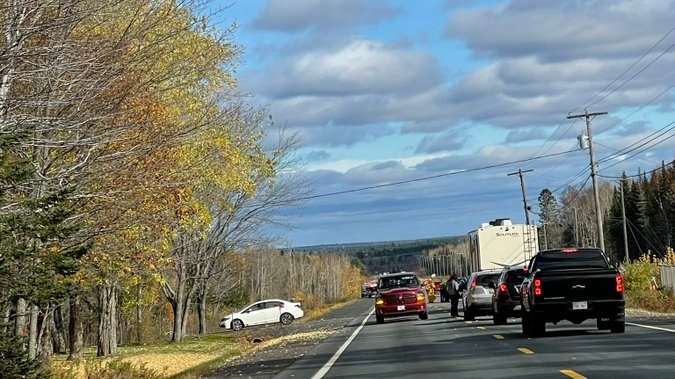 RCMP in New Brunswick are currently on scene of a fatal collision between a bus and a car on Highway 8 near Astle, N.B. (Photo via Andrew Russell / Twitter)