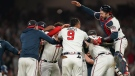 Atlanta Braves celebrate after winning Game 6 of baseball's National League Championship Series against the Los Angeles Dodgers Sunday, Oct. 24, 2021, in Atlanta. (AP Photo/Brynn Anderson)