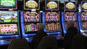 Customers sit at slot machines at Gateway Casino in London, Ont. in this undated file photo. (CTV News London)