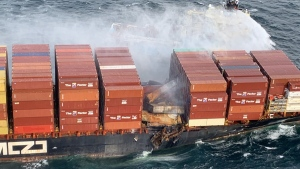 The flames initially spread to 10 containers after another 40 fell overboard in choppy waters on Friday. The fire on the MV Zim Kingston was mostly under control by Sunday afternoon. (Canadian Coast Guard)