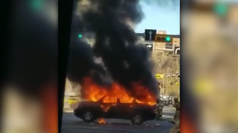 A vehicle on fire in downtown Calgary Sunday. (Supplied)