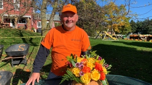 Kevin Shantz shows off some of the pumpkins offered at the Shantz Family Farm (Jessica Smith / CTV Kitchener)