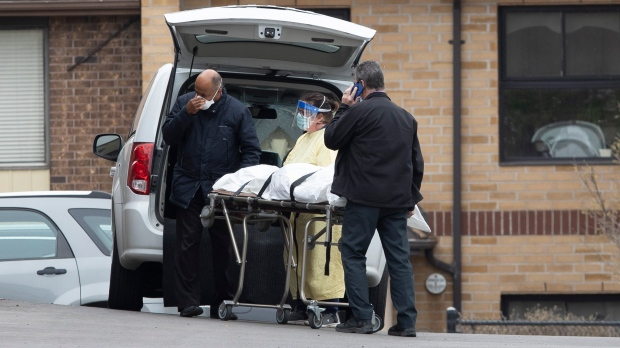 A body is removed from Orchard Villa Care home in Pickering, Ont. on Sunday, April 26 2020. More than half its residents have tested positive for COVID-19. THE CANADIAN PRESS/Chris Young