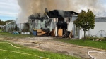 Garage/shop fire on 7285 Base Line Road in Wallaceburg, Ont., on Sunday, Oct. 25, 2021. (Source: Chatham-Kent Fire / Twitter)