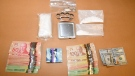 Drugs, cash and brass knuckles seized over the weekend are seen in this image released by the London Police Service on Monday, Oct. 25, 2021.