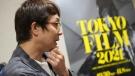 Japanese film director and screenwriter Keisuke Yoshida in Tokyo, on Oct. 5, 2021. (Eugene Hoshiko / AP)