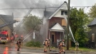 Firefighters work at a structure fire on Hamilton Road in London, Ont. on Monday, Oct. 25, 2021. (Gerry Dewan / CTV News)