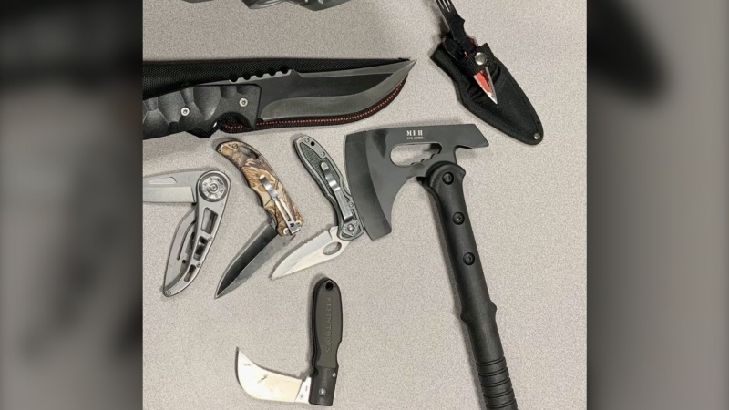 A tactical hatchet and several knives were seized during a Saturday evening traffic stop in connection with an incident at a Lethbridge Walmart where an employee was threatened at knifepoint. (LPS)