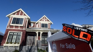 A real estate sold sign is shown outside a house in Vancouver in this file photo taken Jan.3, 2017. THE CANADIAN PRESS/Jonathan Hayward