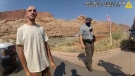 """This Aug. 12, 2021 file photo from video provided by the Moab, Utah, Police Department shows Brian Laundrie talking to a police officer after police pulled over the van he was traveling in with his girlfriend, Gabrielle """"Gabby"""" Petito, near the entrance to Arches National Park in Utah. (The Moab Police Department via AP, File)"""