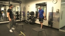 A trainer and gym goer working out at TG Athletics in Kanata (Colton Praill / CTV News Ottawa)