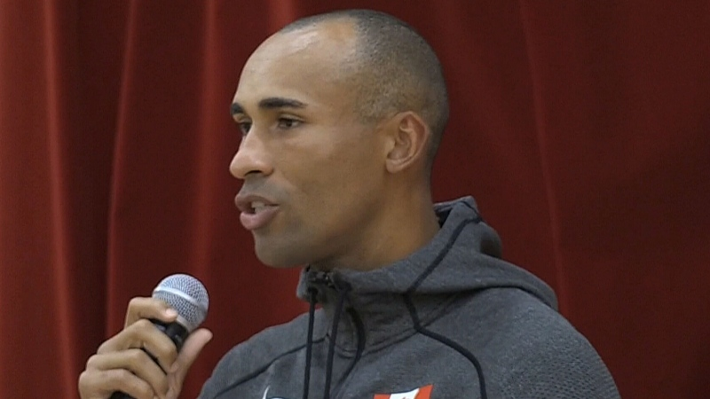 Olympic champion Damian Warner speaks to students