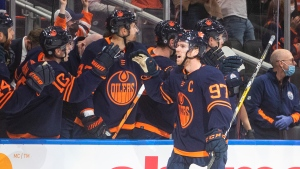 Edmonton Oilers' Connor McDavid (97) celebrates a goal against the Calgary Flames during first period NHL action in Edmonton on Saturday, October 16, 2021.THE CANADIAN PRESS/Jason Franson