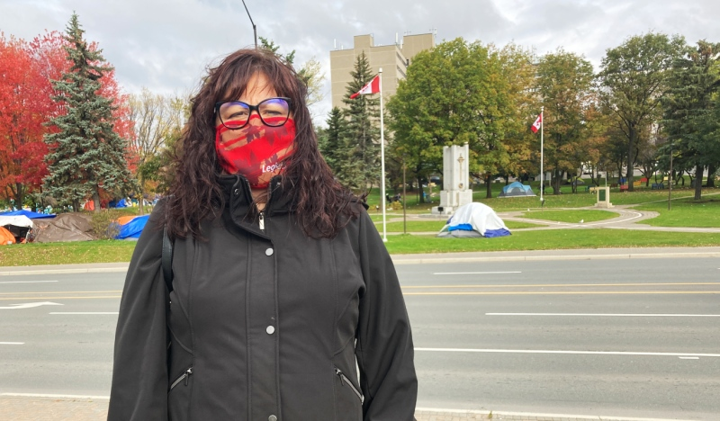 Jennifer Huard, president of the Royal Canadian Legion Branch 564, is seen in front of the cenotaph at Memorial Park. (Alana Everson/CTV News)