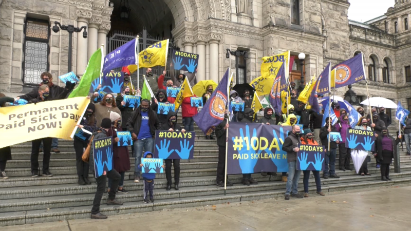 Advocates rally for 10 days of paid sick leave outside the B.C. legislature on Monday, Oct. 25, 2021, in an event organized by the B.C. Federation of Labour.
