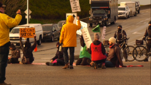 Climate activists protest near Vancouver International Airport on Monday, Oct. 25, 2021.