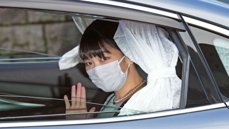 Japan's Princess Mako waves from a car as she leaves her home in Akasaka Estate in Tokyo Tuesday, Oct. 26, 2021. (Chika Oshima/Kyodo News via AP)