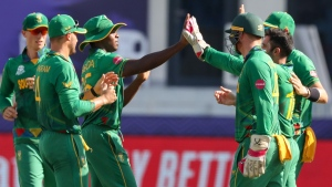South Africa's Kagiso Rabada, third left, is congratulated by teammates after taking a catch to dismiss West Indies' Evin Lewis during the Cricket Twenty20 World Cup match in Dubai, on Oct. 26, 2021. (Kamran Jebreili / AP)