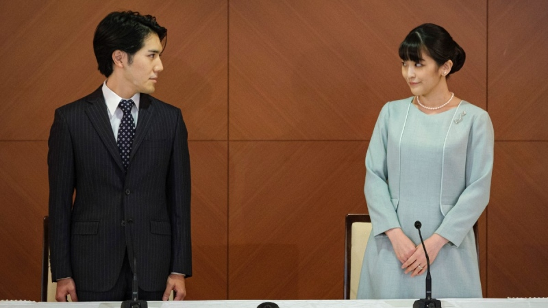 Japan's former Princess Mako, right, and her husband Kei Komuro, during a press conference to announce their marriage, on Oct. 26, 2021. (Nicolas Datiche/Pool Photo via AP)