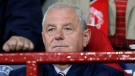 In this Tuesday Sept. 14, 2010 file photo, Rangers' manager Walter Smith, during the first leg of their Group C Champions League soccer match Manchester United , Old Trafford, Manchester, England.