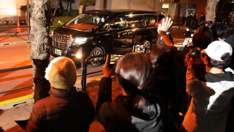 Former Princess Mako and her husband Kei Komuro leaving a press conference in Tokyo by van, on Oct. 26, 2021. (Eugene Hoshiko / AP)