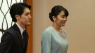 Mako Komuro, right, and her husband Kei after their wedding in Tokyo, Japan, on Oct. 26, 2021. (Nicolas Datiche / Pool Photo via AP)