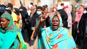 A pro-democracy protester flashes the victory sign as thousands take to the streets to condemn a takeover by military officials, in Khartoum, Sudan, on Oct. 25, 2021. (Ashraf Idris / AP)