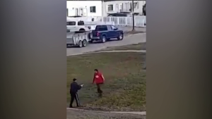 A screenshot from a video posted to social media shows  the moments before a RCMP officer shot a man in Thompson, Man. on Oct. 25, 2021. RCMP said the officer was on Princeton Drive to serve legal documents and encountered a 30-year-old armed with a knife. (Video screenshot)