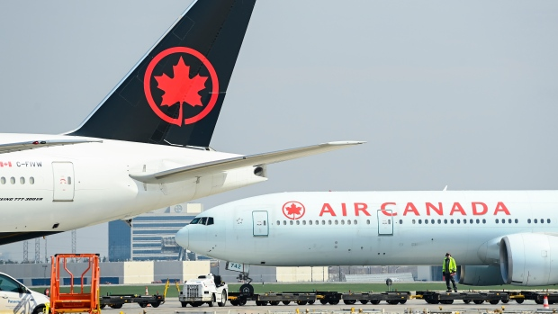Air Canada planes sit on the tarmac at Pearson International Airport during the COVID-19 pandemic in Toronto on Wednesday, April 28, 2021. THE CANADIAN PRESS/Nathan Denette