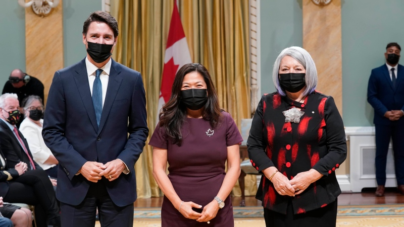 Prime Minister Justin Trudeau, left, and Gov. Gen. Mary May Simon, right, pose with Mary Ng, minister of international trade, export promotion, small business and economic development, at a cabinet swearing-in ceremony at Rideau Hall in Ottawa, Tuesday, Oct.26, 2021 THE CANADIAN PRESS/Adrian Wyld