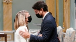 Prime Minister Justin Trudeau, right, congratulates Melanie Joly, minister of foreign affairs, at a cabinet swearing-in ceremony at Rideau Hall in Ottawa, Tuesday, Oct.26, 2021 THE CANADIAN PRESS/Adrian Wyld