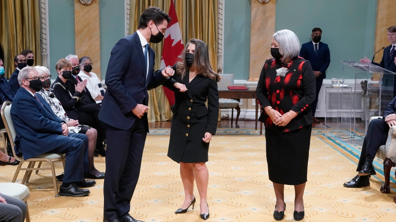 Prime Minister Justin Trudeau bumps elbows with Deputy Prime Minister and Minister of Finance Chrystia Freeland as Gov. Gen. Mary May Simon looks on ahead of the cabinet swearing-in ceremony at Rideau Hall in Ottawa, Tuesday, Oct.26, 2021 THE CANADIAN PRESS/Adrian Wyld