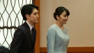 Japan's former Princess Mako, right, the elder daughter of Crown Prince Akishino and Crown Princess Kiko, and her husband Kei Komuro, leave after a press conference to announce their marriage, at a hotel in Tokyo, Japan, Tuesday, Oct. 26, 2021. Former Princess Mako married the commoner and lost her royal status Tuesday in a union that has split public opinion after a three-year delay caused by a financial dispute involving her new mother-in-law. (Nicolas Datiche/Pool Photo via AP)