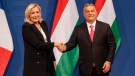 French far-right leader Marine le Pen, left, shakes hands with Hungarian Prime Minister Viktor Orban after a joint press conference in Budapest, Hungary, on Oct. 26, 2021. (Laszlo Balogh / AP)