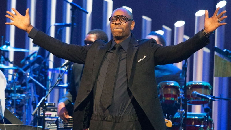 In this Oct. 27, 2019 file photo, Dave Chappelle is honored with the Mark Twain Prize for American Humor at the Kennedy Center for the Performing Arts in Washington. (Photo by Owen Sweeney/Invision/AP, File)