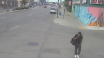 Surveillance footage shows a suspect wanted for a pair of robberies on Main Street where a substance believed to be bear spray was used. (Image source: Winnipeg Police Service)