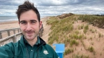 Parks Canada climate change specialist Garrett Mombourquette is shown at the coastie station at Prince Edward Island National Park in a handout photo. Parks Canada has launched a new citizen science program called the Coastie Initiative to allow visitors to five national parks in the county to take a picture of the coast using their smartphones. THE CANADIAN PRESS/HO/Parks Canada