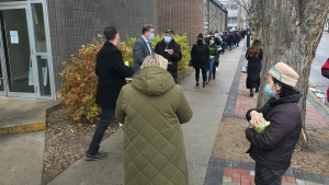 A long line formed outside the Saskatoon Chamber of Commerce on Tuesday. (Dale Cooper/CTV News)