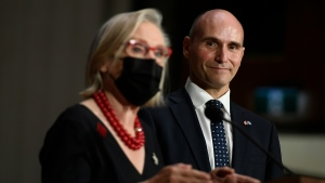 Minister of Health Jean-Yves Duclos listens as Minister of Mental Health and Addictions and Associate Minister of Health Carolyn Bennett responds to a question at a news conference after the federal cabinet was sworn in, in Ottawa, on Tuesday, Oct. 26, 2021. THE CANADIAN PRESS/Justin Tang