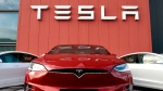 Tesla just became the sixth company in U.S. history to be worth $1 trillion. (John Thys/AFP/Getty Images)