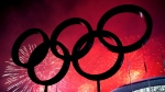 FILE - The Olympic Rings are silhouetted as fireworks light up the sky during the closing ceremonies at the 2014 Sochi Winter Olympics in Sochi, Russia on Sunday, February 23, 2014. THE CANADIAN PRESS/Nathan Denette