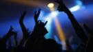 People dancing in a nightclub are seen in this stock image (Pexels/Aleksandar Pasaric)