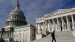 A man walks past the the U.S. Capitol, Wednesday, Oct. 27, 2021, on Capitol Hill in Washington. (AP Photo/Patrick Semansky)