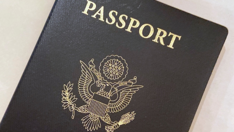 FILE - This May 25, 2021 file photo shows a U.S. Passport cover in Washington.  (AP Photo/Eileen Putman)