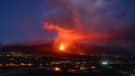 Lava flows from a volcano as it continues to erupt on the Canary island of La Palma, Spain, Tuesday, Oct. 26, 2021. Officials say a volcano erupting for the past five weeks on the Spanish island of La Palma is more active than ever. New lava flows have emerged following a partial collapse of the crater and threaten to engulf previously unaffected areas. (AP Photo/Emilio Morenatti)