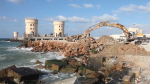 This image from a video shows concrete barriers being put up to protect the coastal city of Alexandria from rising tides.